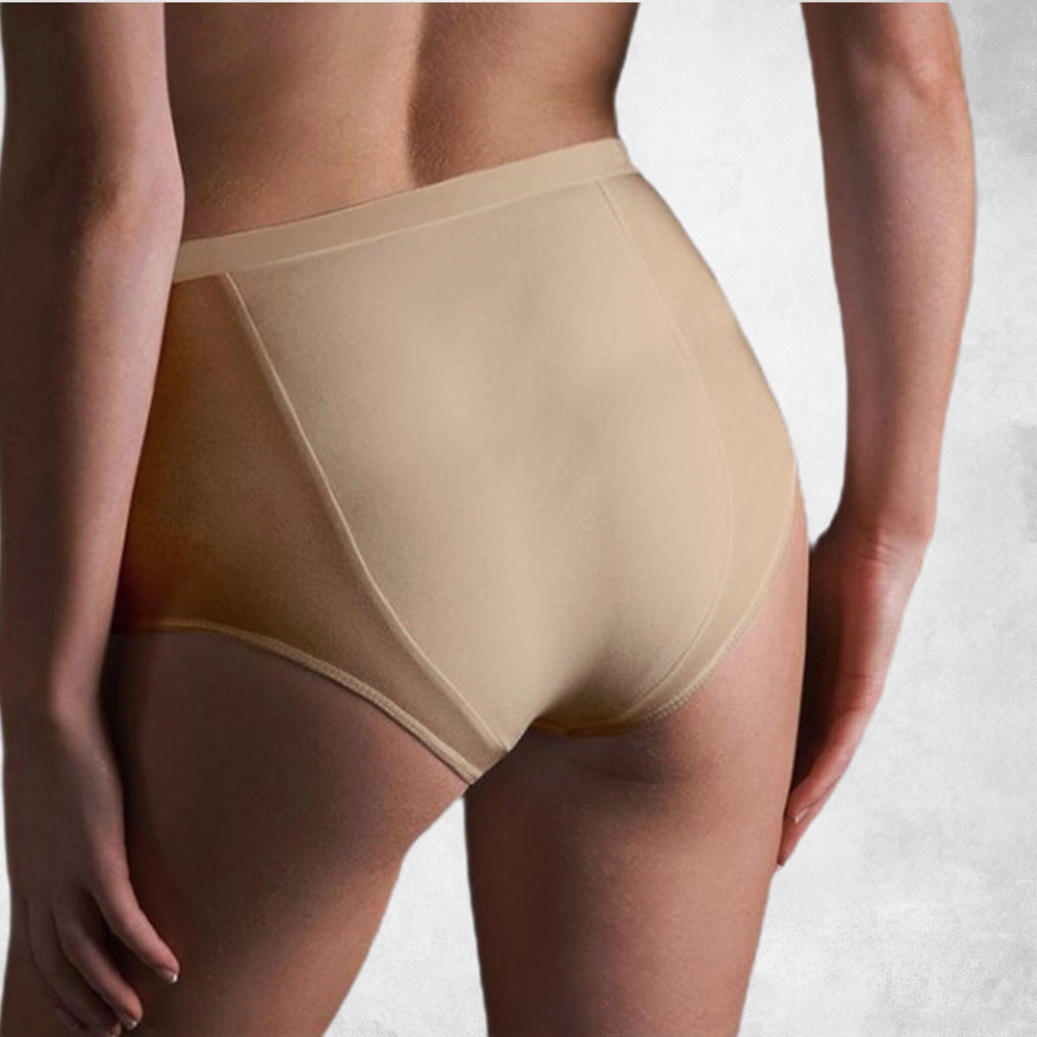 antybąkowa bielizna damska kolor cielisty głębokie majtki na bąki, widziane od tyłu, na zdjęciu widać głównie pupę szczupłej modelki